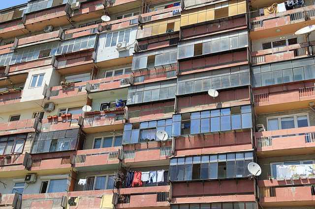 Можно ли взять ипотеку в другом городе, многоэтажный дом густо населенный